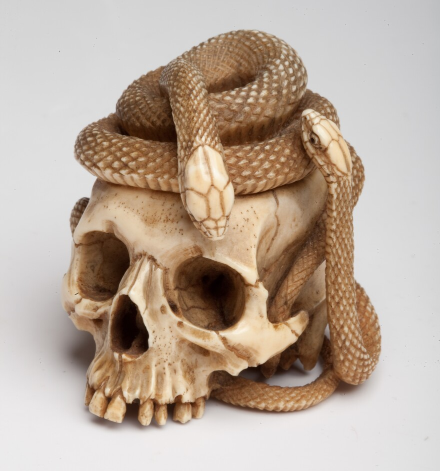 <em>Skull with two snakes (Netsuke), approx. 1800–1900. Japan. Ivory; inlaid horn.</em>