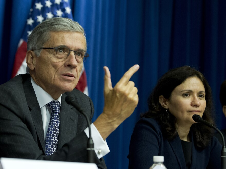 Federal Communications Commission Chairman Tom Wheeler (left) speaks Oct. 8 during a news conference in Washington. Wheeler has spoken in favor of regulating Internet providers as public utilities, an issue the commission is expected to decide on this month.