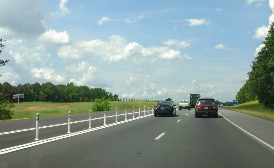 Barriers separate free lanes from toll lanes (left) on I-77 north of Charlotte. The northern section of the toll lanes is scheduled to open to traffic on Saturday, June 1.