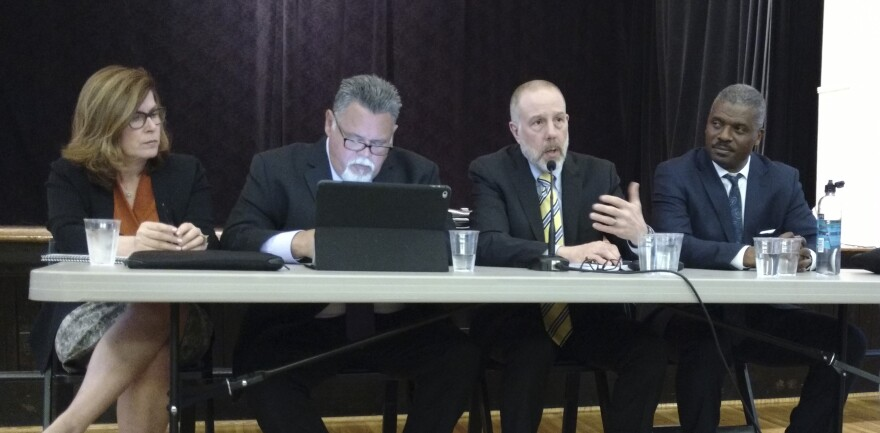 The Police Foundation review team at Wednesday's meeting, from left: chief operating officer Blake Norton, Roberto Villasenor, Frank Straub, and the Rev. Jeffrey Brown.