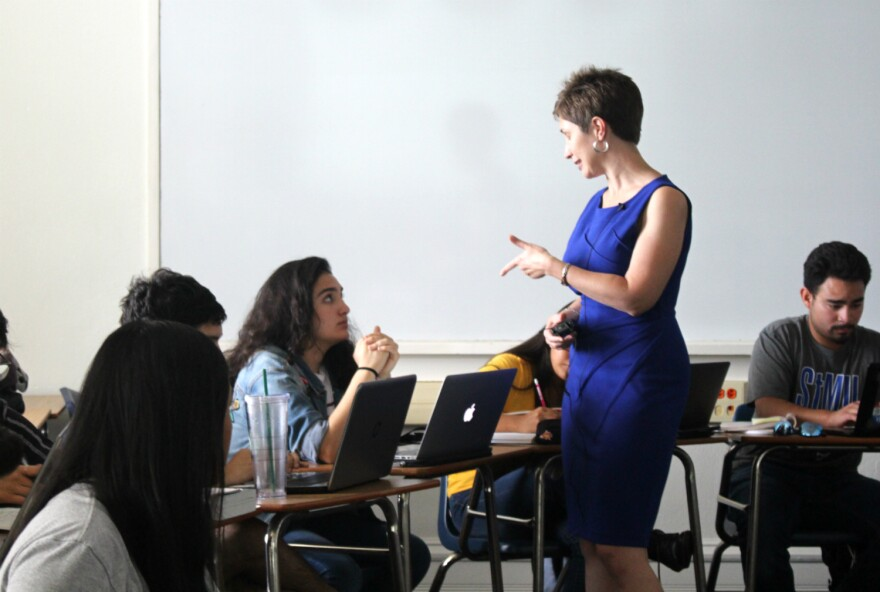 St. Mary's University Professor Meghann Peace speaks to a student in her Heritage Spanish class on Sept. 23, 2019.