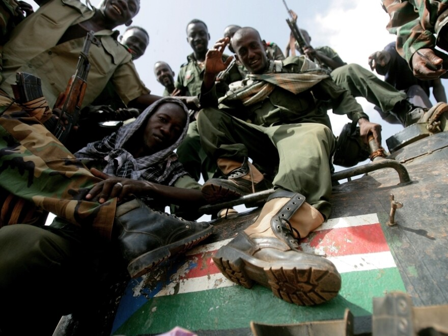 Sudanese soldiers step on the South Sudan flag painted on a seized tank for the Sudanese Peoples Liberation Army in Heglig last month.