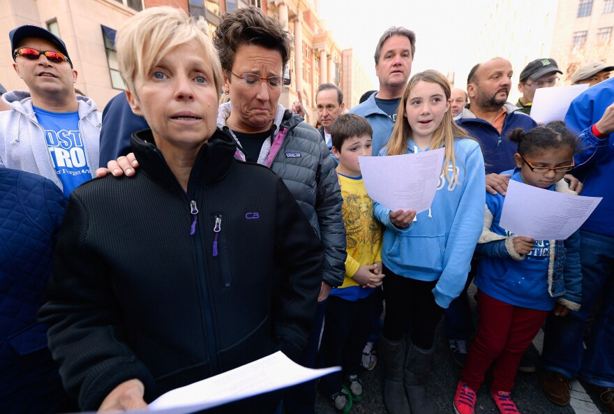 People participate in an interfaith memorial service with members of six churches near the site of Monday's Boston Marathon bombings.