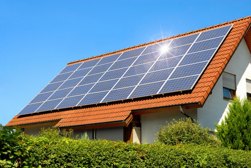 Utility companies say if lots of people suddenly start using solar panels on their roofs, it would cause a huge disruption to the electric system.