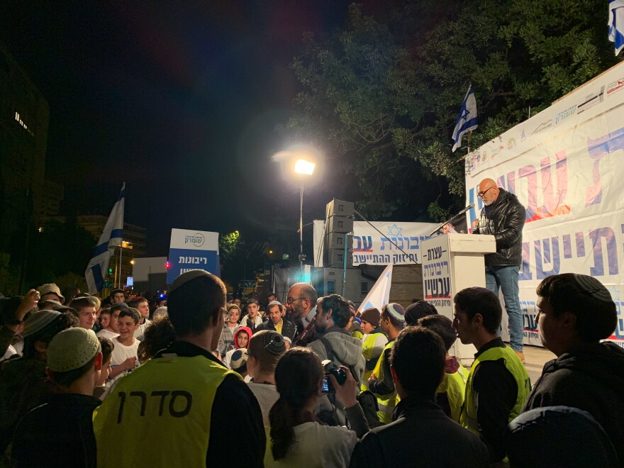 Alhayani speaks on stage to young Jewish settler activists rallying outside Netanyahu's residence in Jerusalem. They are calling for the prime minister to declare Israeli sovereignty over occupied West Bank land.