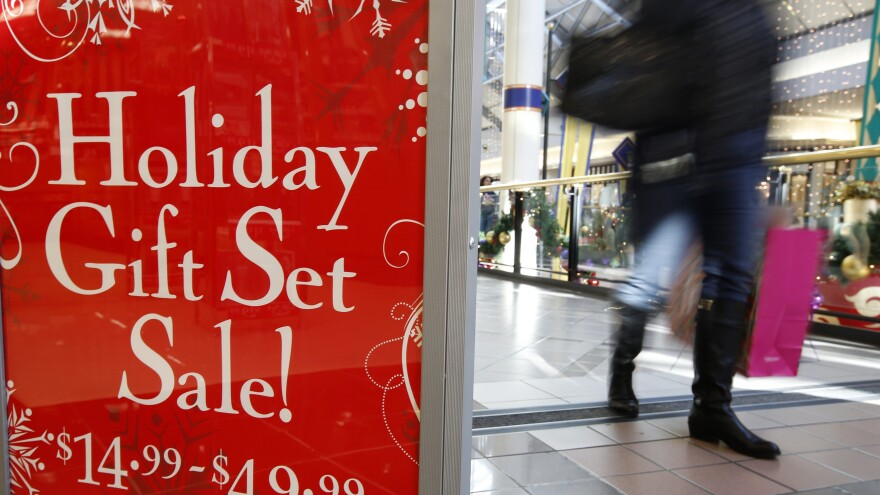 A retail store at the CambridgeSide Galleria mall in Cambridge, Mass., advertises holiday sale, Monday, Dec. 24, 2012.