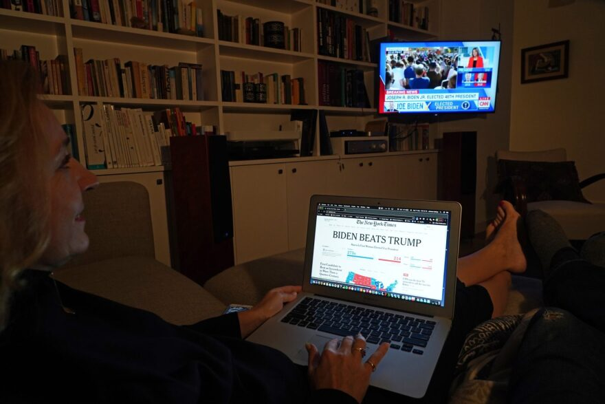 The photographer and his wife watch CNN as U.S. media confirm their projection of a win by Democrat Joe Biden in the U.S. presidential election.