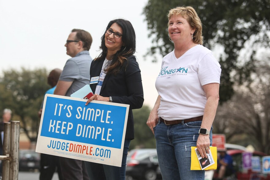 Judge Dimple Malhotra greets voters on Election Day in March with then-candidate for Travis County sheriff, Liz Donegan.