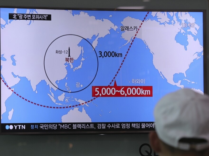 A man watches a TV screen showing a local news program reporting on North Korea's missiles at the Seoul Train Station in Seoul, South Korea, on Wednesday.