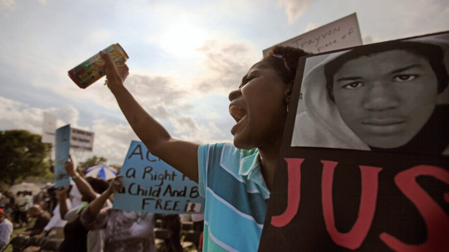 Lakeshe Hall demonstrates at a rally for slain teenager Trayvon Martin on Thursday in Sanford, Fla.