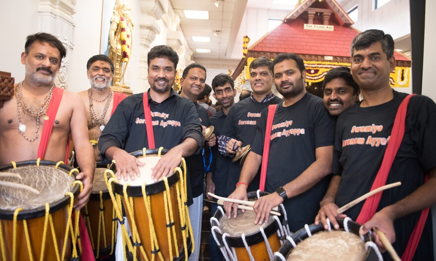 Members of the Hindu Temple of St. Louis with traditional percussion instruments.