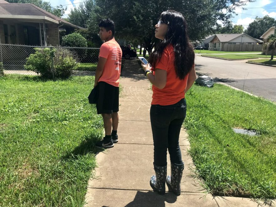 Volunteers with United We Dream in Houston block walk to ask East End residents to vote with Dreamers in mind.