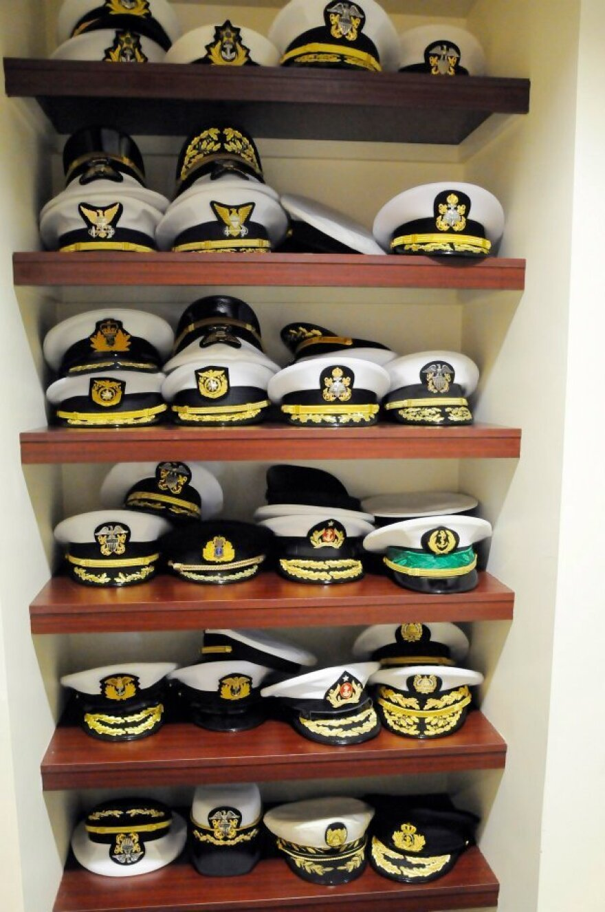 A stack of covers from senior leaders of international navies sits on a shelf during the 20th International Seapower Symposium at the U.S. Naval War College in Newport, R.I., in 2011. Senior military officers from around the world frequently visit the U.S. on official exchanges, such as the one in Virginia in which the Turkish officers took part.