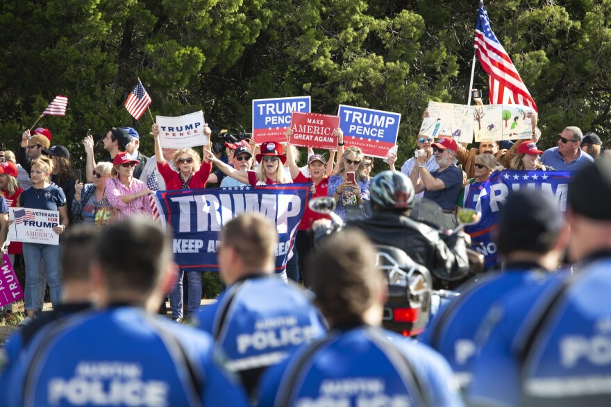 Trump supporters rally ahead of a visit by the president in Austin last year.
