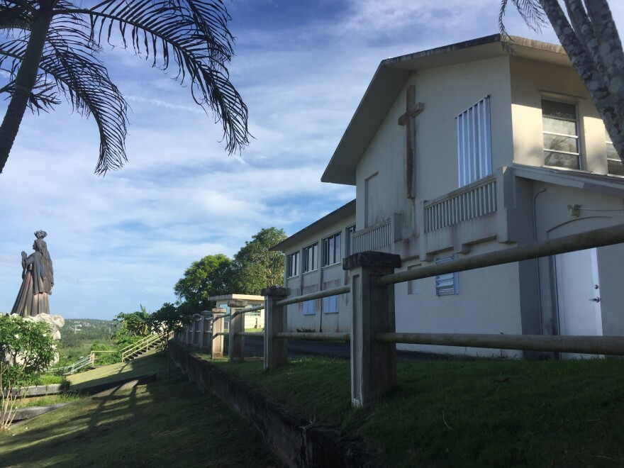 The office and residence of the Archbishop of Agana in Guam, seen Wednesday. The house was listed as one of the non-essential properties owned by the Catholic Church in the U.S. territory, which announced that it will file for bankruptcy.