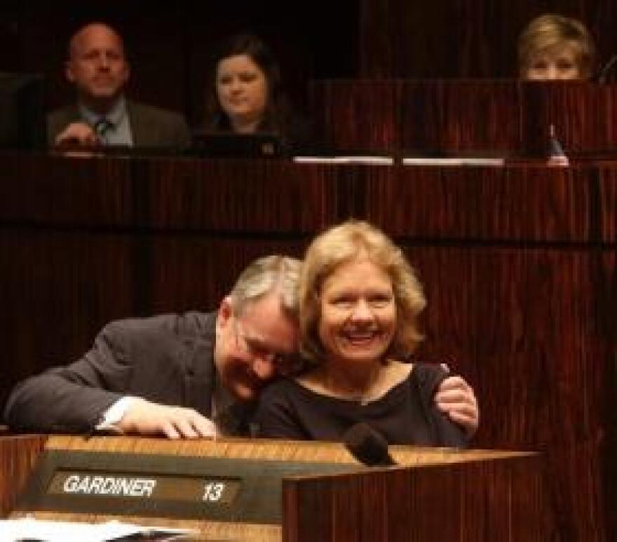 Outgoing Senate President Don Gaetz hugs his wife, Vicki, during a ceremony honoring him at the Capitol.