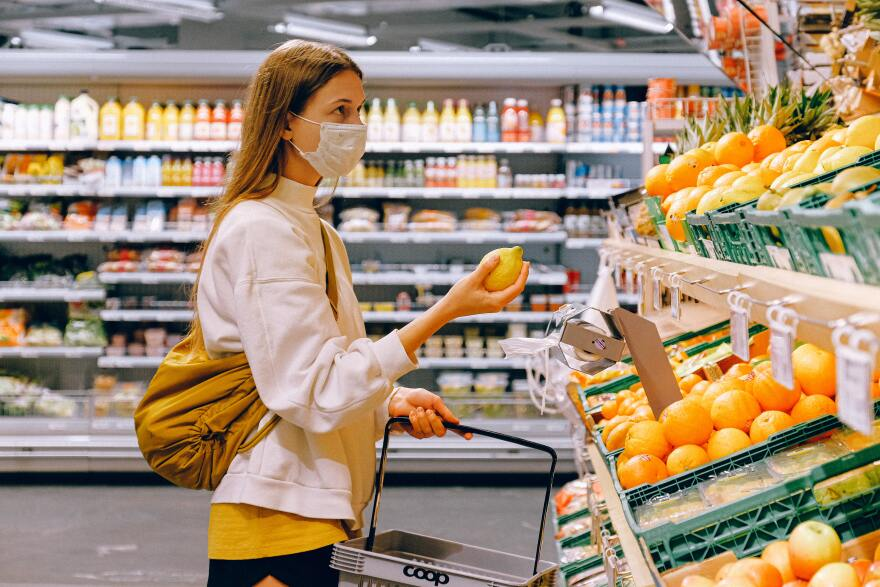 woman-in-yellow-tshirt-and-beige-jacket-holding-a-fruit-3962285.jpg