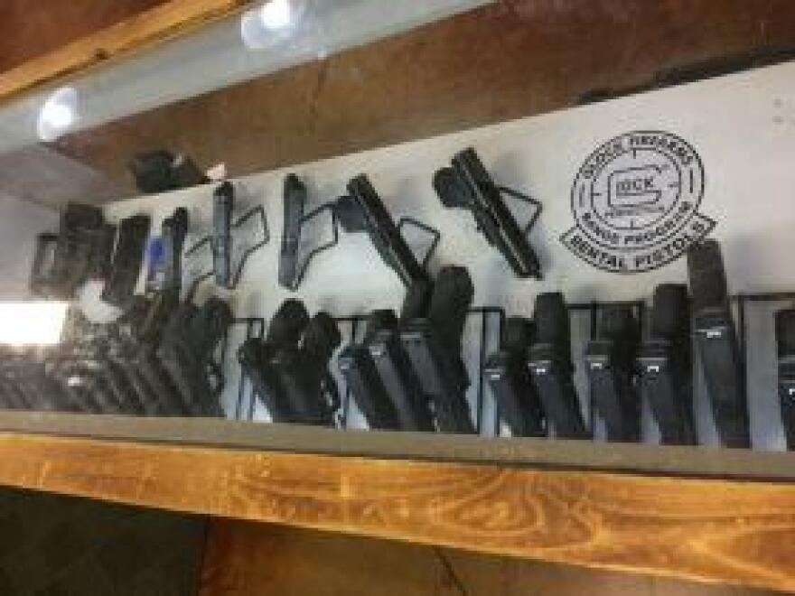 A retail gun case filled with semi-automatic weapons is now off-limits to Arkansas medical marijuana users.