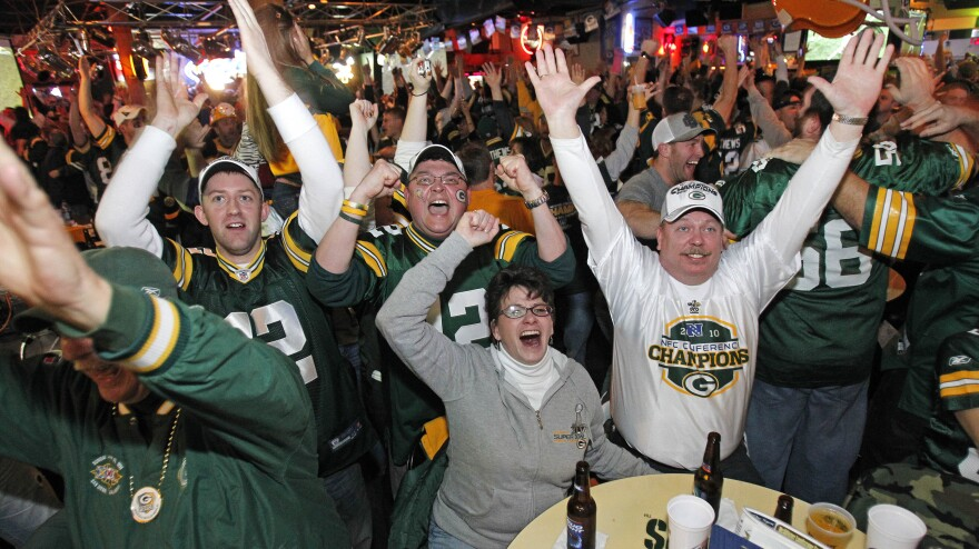 Will these Green Bay fans be cheering as much as they did during the 2011 Super Bowl when their beloved Packer games are interrupted by local political ads this fall?