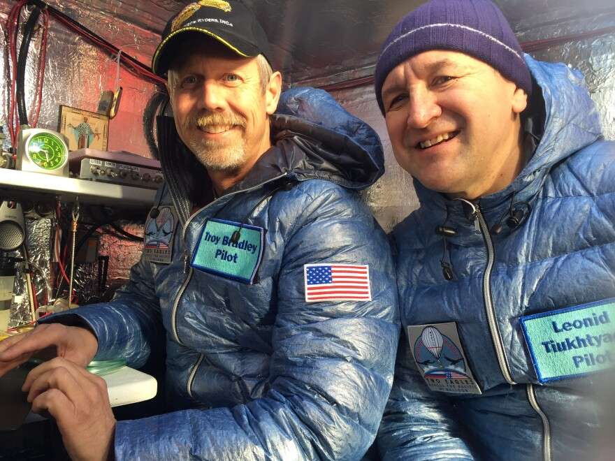 A photo provided by Tami Bradley-Two Eagles Balloon Team, shows pilots from left, Troy Bradley of Albuquerque, N.M., and Leonid Tiukhtyaev of Russia, before their liftoff in a gas balloon in Saga, Japan.