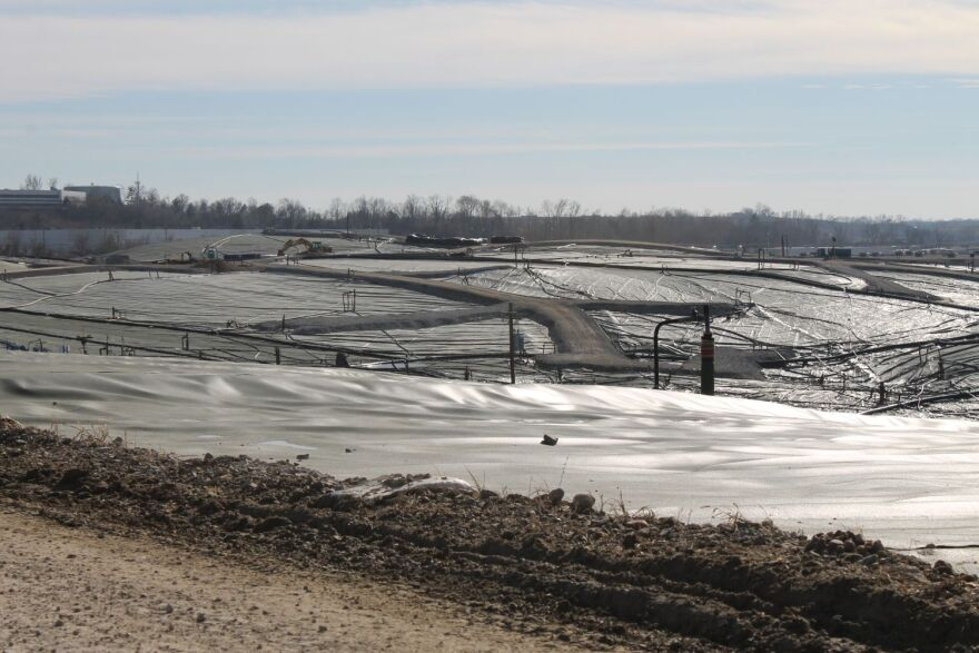 This photo taken in February 2015 of the Bridgeton Landfill's south quarry shows the plastic cap and several gas extraction wells.