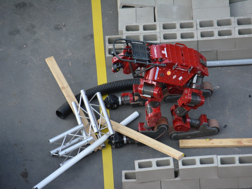 For this part of the course, robots can either walk over the cement bricks or plow through. Carnegie Mellon's CHIMP tries the latter.