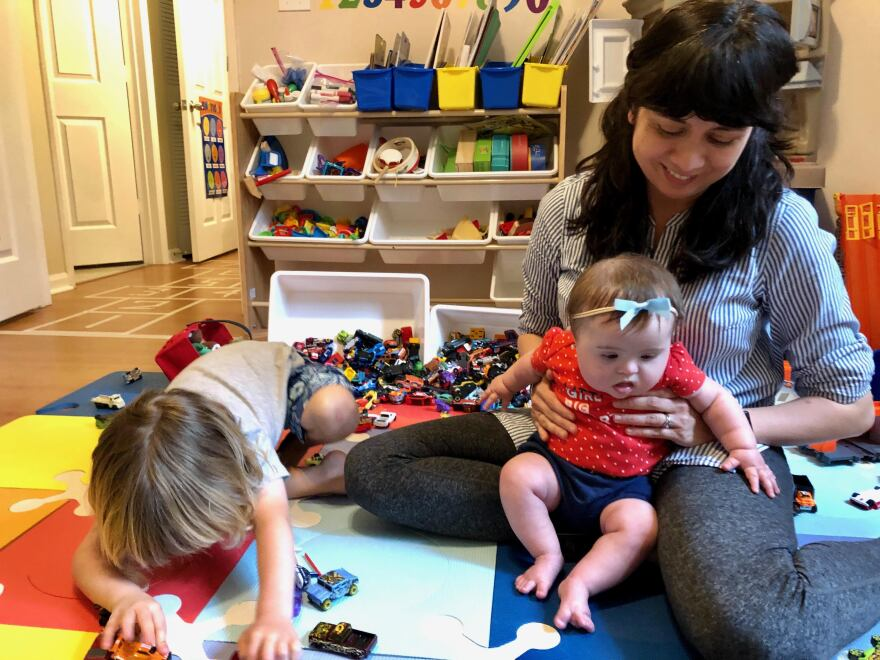 Doris Bravo-Hieger playing with her two children, Oliver and Penelope.