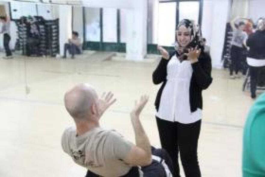 Dwayne dances with Ruba, a deaf Palestinian girl.