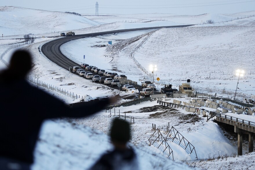 Vehicles line a road near a blocked bridge next to the Oceti Sakowin camp where protesters  gathered in Cannon Ball, N.D. Much of the Dakota Access pipeline project controversy has been a small portion running under the Missouri River. Members of the Standing Rock Sioux tribe, whose reservation lies just downstream, have worried that a leak could contaminate their drinking water and sacred lands.
