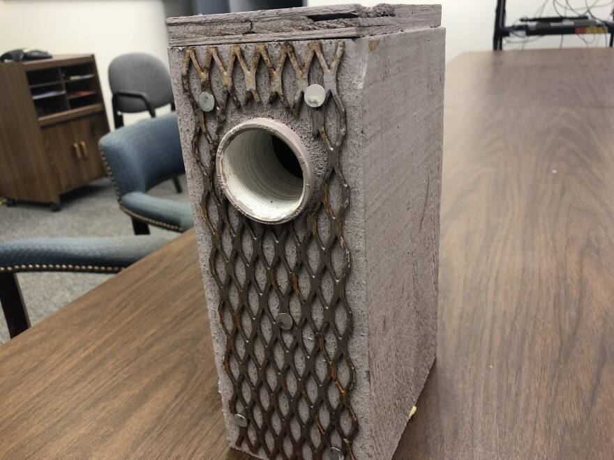 An artificial cavity at Tall Timbers ready to be inserted into a pine tree. The metal on the outside of the box prevents other woodpecker species from widening the box's hole in order to move in.