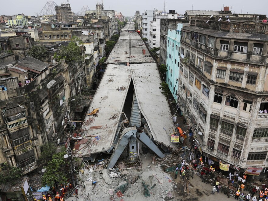 At least 24 people died in the collapse of a large section of an overpass Thursday in Kolkata, India.