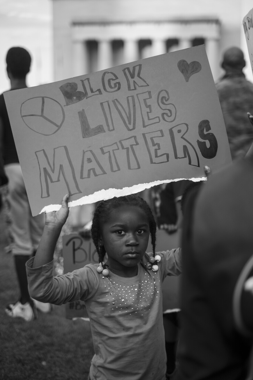 A young girl at a Baltimore City Hall rally, May 3, 2015.