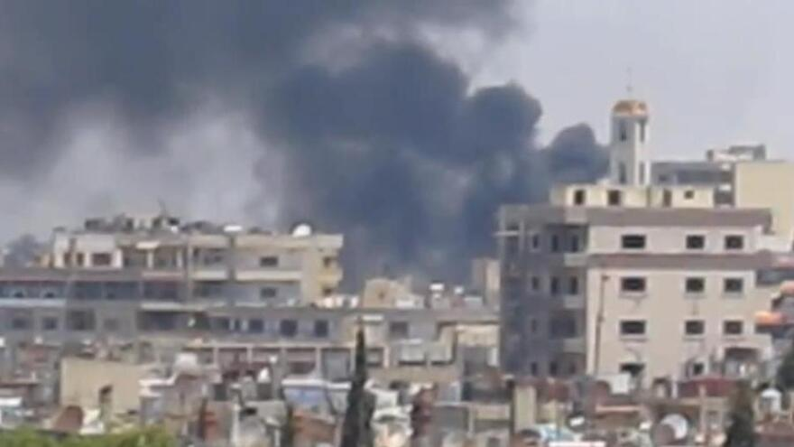 A frame grab from a video taken by U.N. observers as smoke rose over the Syrian city of Homs earlier this week. The observers said Homs had been shelled by Syrian government forces.