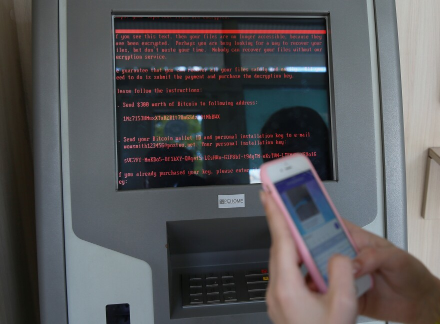 A message demanding money is seen on a terminal monitor at a branch of Ukraine's state-owned Oschadbank after Ukrainian institutions were hit by a wave of cyberattacks earlier Tuesday in Kiev, Ukraine.