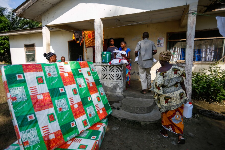 A family receives a mattress, a bag of rice, cooking oil, blankets and bleach for each child it adopts.