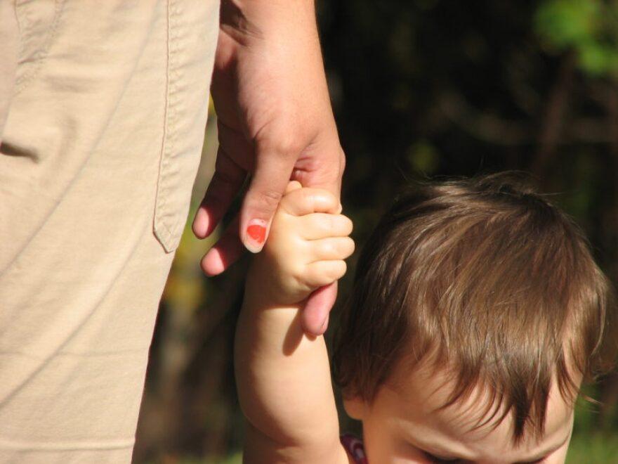 kid_holding_hand.jpg