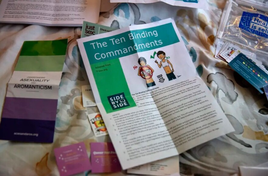 Atticus Sandlin has a variety of pamphlets, stickers, types of contraception and informational resources to provide to anyone who needs them.