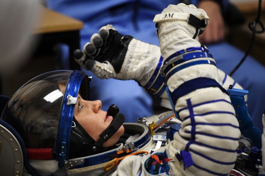 NASA astronaut Anne McClain reacts as her space suit is tested prior to the launch of the Soyuz MS-11 spacecraft on Dec. 3, 2018.