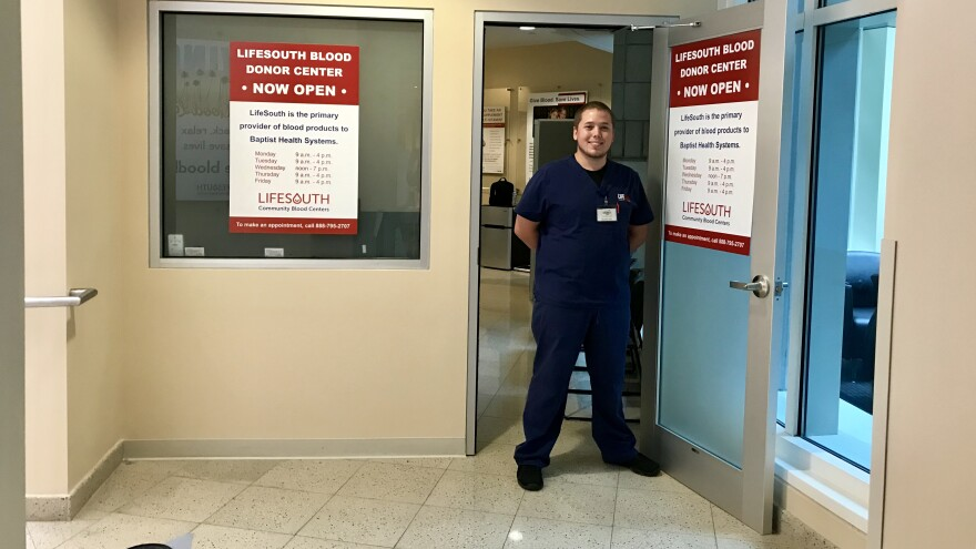 Technician Ryan McGowan greets visitors at the new LifeSouth blood donation center inside Baptist hospital downtown.