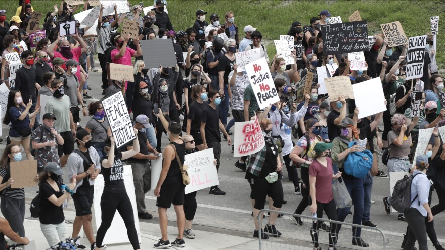 Demonstrators march during a protest over the death of George Floyd, Tuesday, June 2, 2020, in Orlando, Fla. Floyd died after being restrained by Minneapolis police officers on May 25.