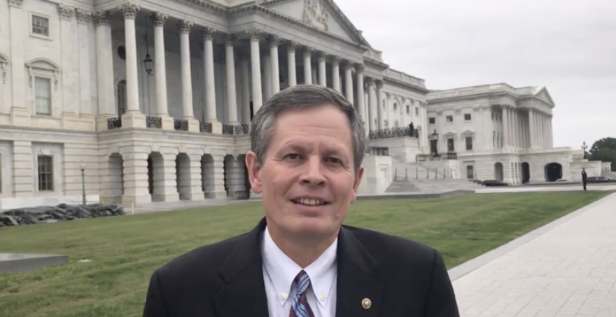 Steve Daines stands outside the U.S. Capitol building.
