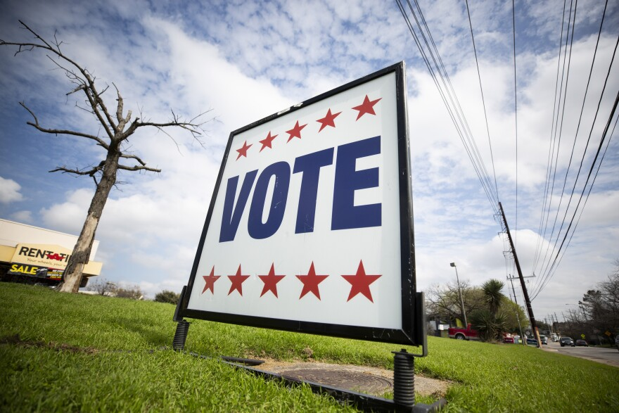 A sign notifies people where they can vote.