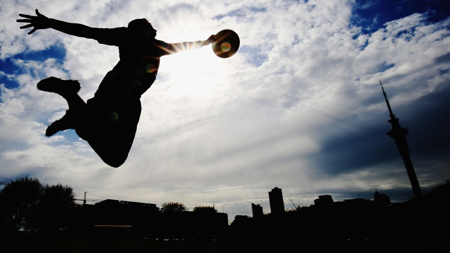 New Zealand Ultimate Frisbee player Zev Fishman dives for a frisbee during a photoshoot in October 2015.