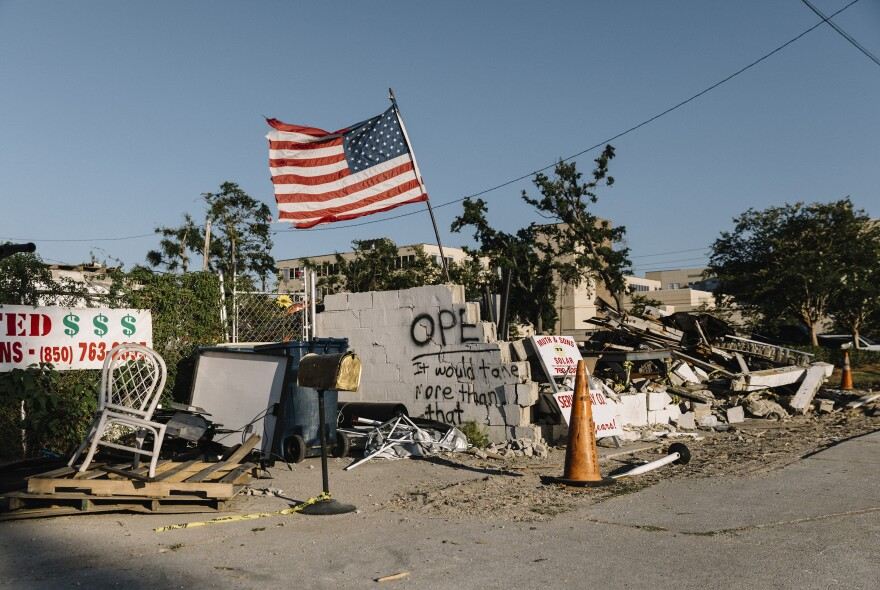 An American flag flutters above a pile of rubble near downtown Panama City.