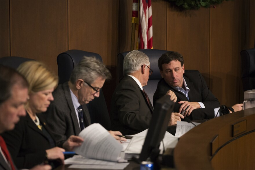 St. Louis County Executive Steve Stenger confers with Councilman Pat Dolan at a Dec. 19, 2017, meeting of the St. Louis County Council.