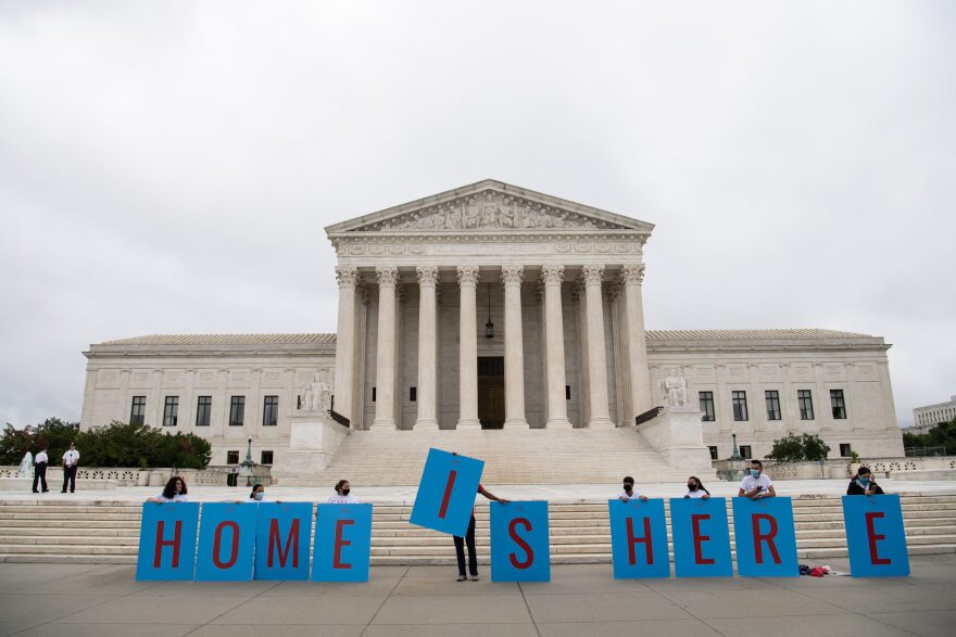 Activists hold a banner in front of the US Supreme Court in Washington, DC, on June 18, 2020. (NICHOLAS KAMM/AFP via Getty Images)