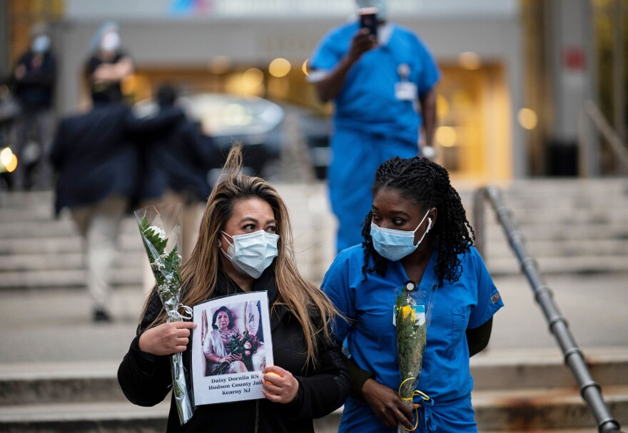 Nurses and health care workers mourn colleagues who died during the pandemic at a demonstration in April outside Mount Sinai Hospital in Manhattan.