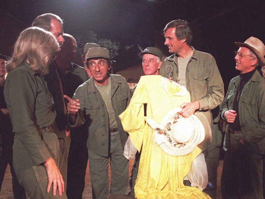 William Christopher (far right) was best known for his role as Father Mulcahy on the 1970s TV show <em>M*A*S*H</em>. He died Saturday in California at the age of 84.