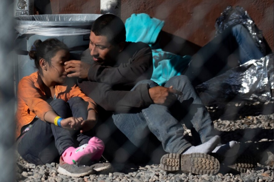A family under the Paso del Norte bridge in El Paso. The makeshift facility where U.S. Border Patrol housed migrants was open air and surrounded by barbed wire fence.