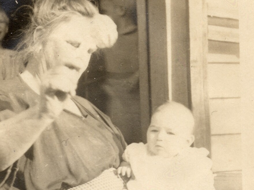 "The only surviving photo of Vivian Buck, here with her adoptive mother in 1924. This is the moment Vivian is determined by a eugenics researcher to be ""feeble-minded"" for not looking at a coin held in front of her face."